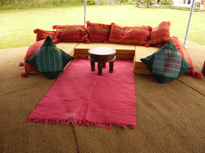 Marquee furniture hire - Selection of rugs and cushions, red, purple, blue, pink and other colours available