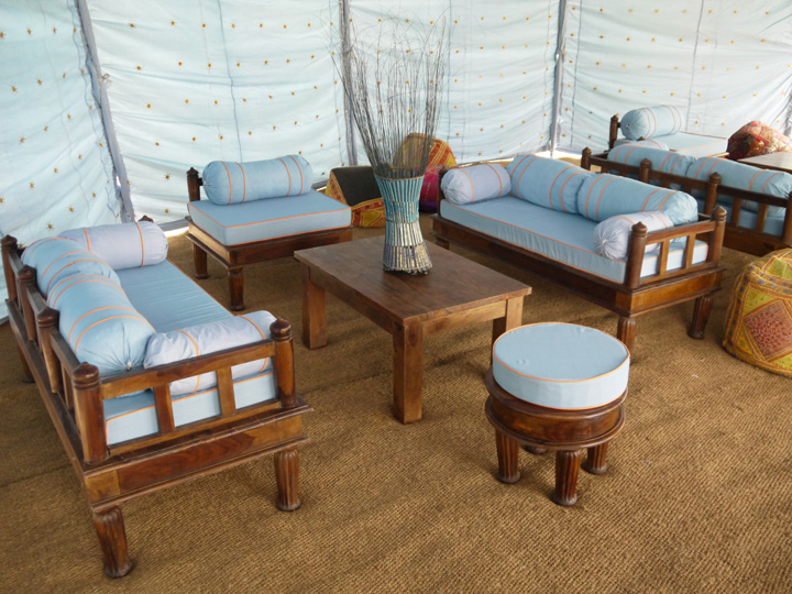 Marquee furniture hire - Oak furniture with blue cover cushions, oak coffee table, lamps